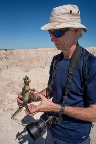 Robert Breshears encounters T-Rex in the Badlands. © Terry Ownby