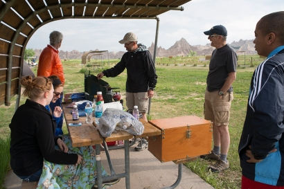 Making an early breakfast in camp at the Badlands. Left to right: Amy, Megan, Robert, Tom, John (ISU), and Michael. © Terry Ownby