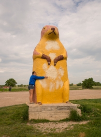 Megan gets a hug from a giant prairie dog in South Dakota! © Terry Ownby